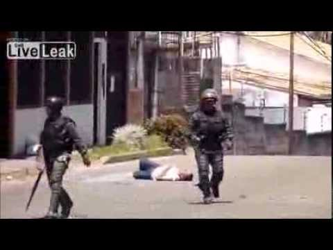 Venezuela riots Man gets punched and kicked by National Guard members GNB 2014