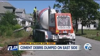 Woman angry over cement truck dumping