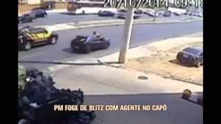 PM foge de blitz levando agente de tr�nsito no cap� do carro