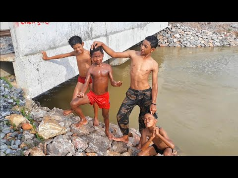 Funny Boys Swimming And Jump Into Water Of Lake