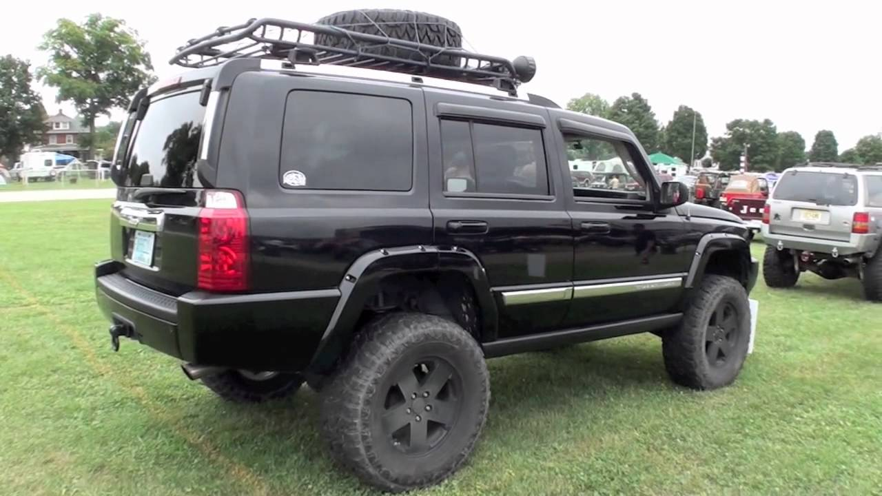 Jeep Commander XK on big lift and 35 inch tires - YouTube