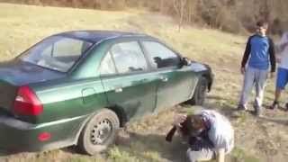 Crazy guy trying to break car window with his head - Funny !