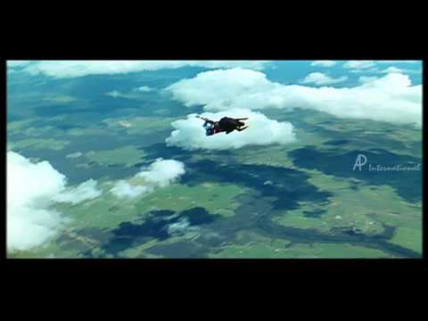 Genelia D'Souza and Ram Charan Teja fly in parachute