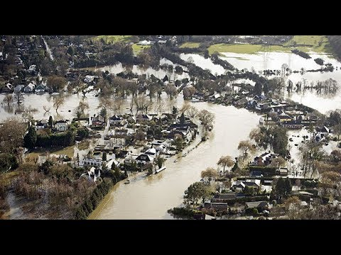 Aerial footage shows the extent of flooding along the Thames