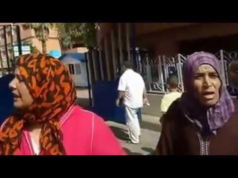 امرأة تستنجد من آيت بوكماز امام المستشفى الجهوي ببني ملال