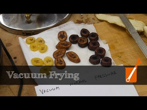 Vacuum and pressure frying fruits and vegetables
