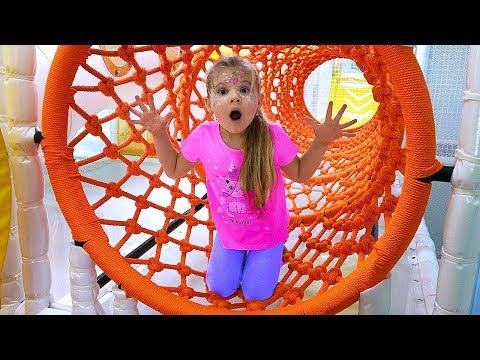 Diana and Roma have fun playing at the Indoor Playground for kids