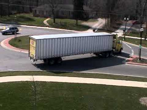 Semi-truck makes U-turn at roundabout