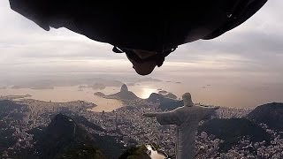 Wingsuit Flight Under Arm of Christ Statue in Rio de Janeiro