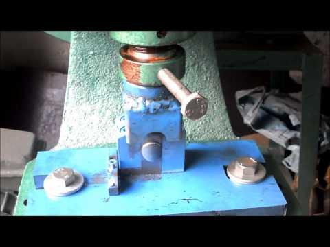 Máy dập khuyết miệng ống inox