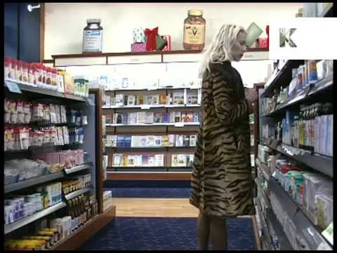 Mid 1990s UK Health Food Shop, Woman Browses Slimming Products, Archive Footage
