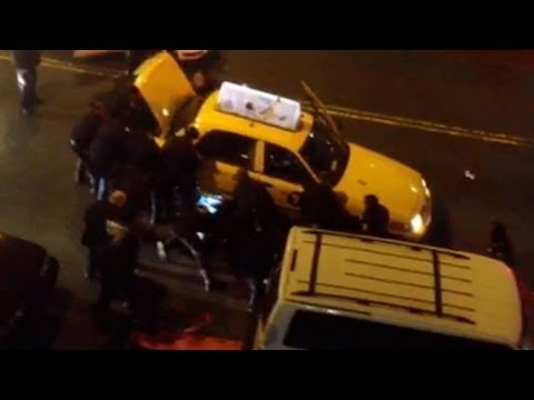 Caught on Tape: NYPD Cops Lift Taxi Cab Car To Rescue A Man!