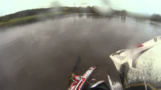 [Riding a snowmobile on a flood] Video