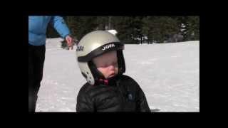 Boy Sleeping while Skiing