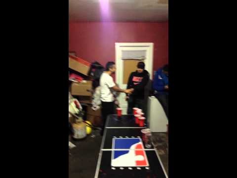 Making the last cup in beer pong! Game winner!