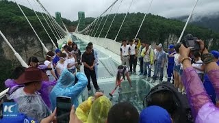 Can world's longest glass bridge withstand sledgehammer blow?
