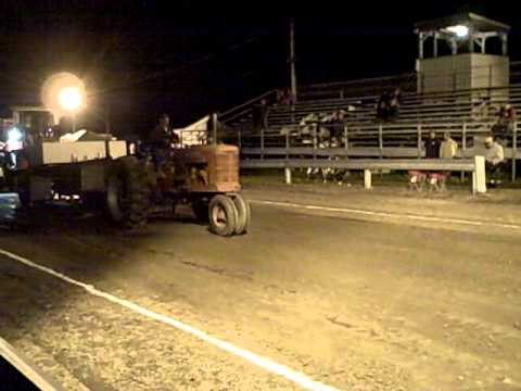 Eerie Farmall M night tractor pull wheelie