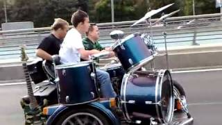 Rock Band Plays on a Motorcycle Driving Down the Freeway