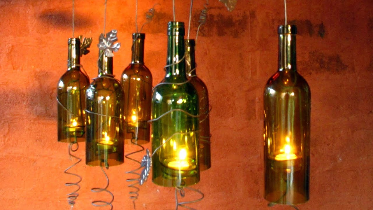recycled wine bottles made into a hurricane candle holder