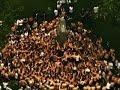 Raw: Hundreds Climb Monument at Naval Academy..