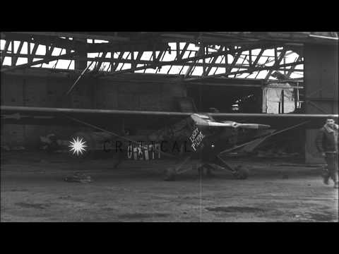 Pilot loads rocket launcher on United States Piper L-4 Grasshopper aircraft at an...HD Stock Footage