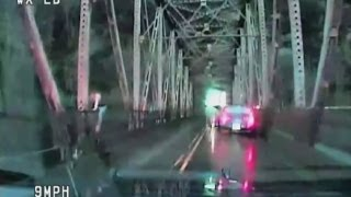 Caught on camera: Woman jumps off bridge after high-speed police chase