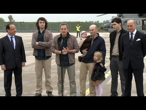 Happy homecoming for French reporters held captive in Syria