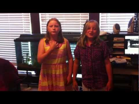 Dog singing with grand daughters