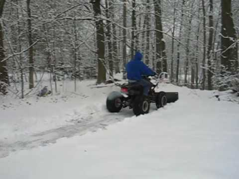 plowing snow honda 300ex home made plow 2wd.mp4