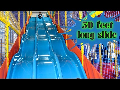 Indoor playground family fun for kids play center slides for Indoor play slide