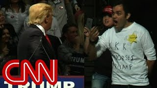 Trump stares down man in 'KKK' shirt