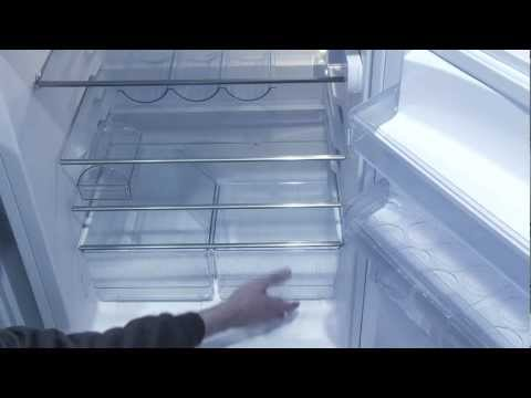 How to fix water leaking into bottom of refrigerator
