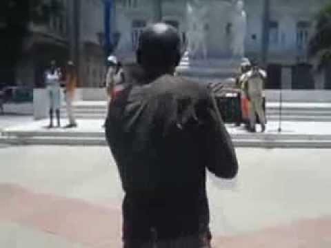 Cuban political police patrol Havana park during cultural event