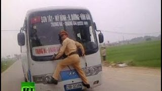 Vietnam: Cop Clings to Speeding Bus Window