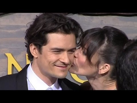 Orlando Bloom Gets A Kiss From Evangeline Lilly At 'The Hobbit' L.A. Premiere