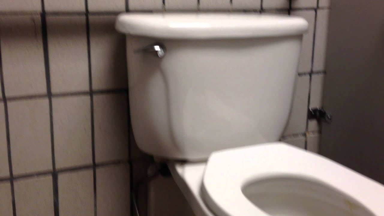 053 A Wall Mounted American Standard Toilet With A Tank