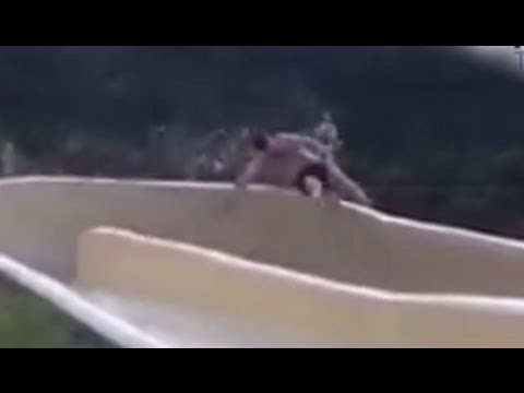 Man Flies Off Water Slide, Down Rocky Cliff [CAUGHT ON TAPE]