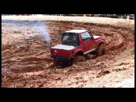 (#12) Little red mudder/ black push bar and winch@ numidia mud bog/ok4wd sponsored event