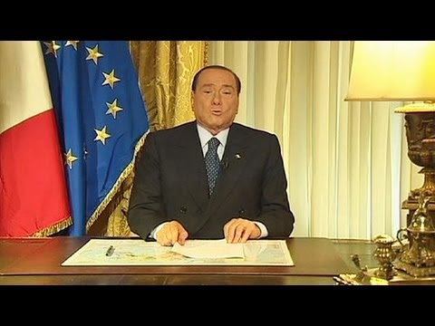 Defiant Berlusconi pushes Italy's government to the brink