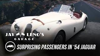 Jay Leno Surprises Passengers in His '54 Jaguar - Jay Leno's Garage. Watch online.