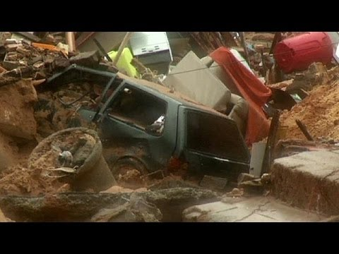Landslide in Brazil World Cup host city destroys homes