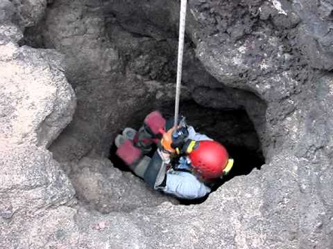 Jugging Out of a Lava Tube Cave, Mojave Desert, California