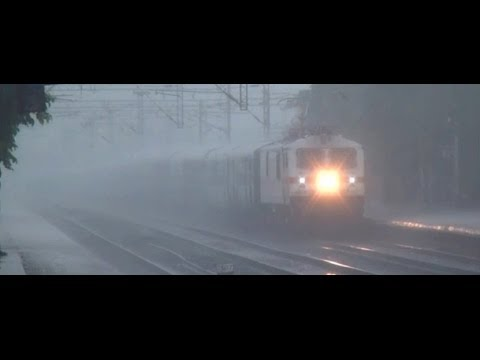 EXPRESS TRAINS IN INDIA TAKEN IN HEAVY RAINS, FREEZING WINTER, SPRING & SUMMER SEASONS