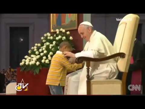 Boy won't leave Pope Francis alone