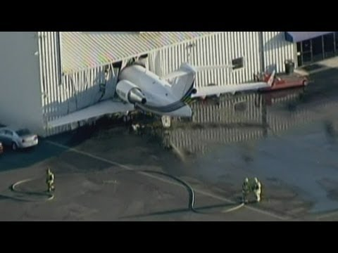 Plane crashes into airport hangar during engine test in Chino, California