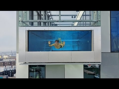 GLASS SWIMMING POOL 1000 FEET IN THE SKY