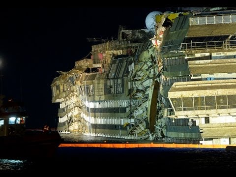 The WRECK of Italy's Costa Concordia cruise ship begin to EMERGE from water
