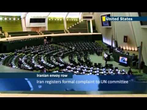 Obama signs law barring Iran UN envoy