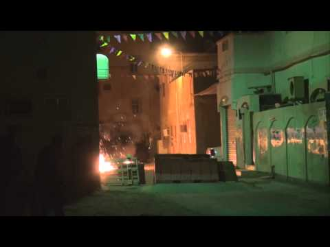 Clashes between protesters and police in sitra, preparing for the third year of bahraini revolution