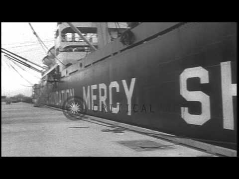 People gather at the dock as a US mercy ship to Korea is being loaded with food, ...HD Stock Footage